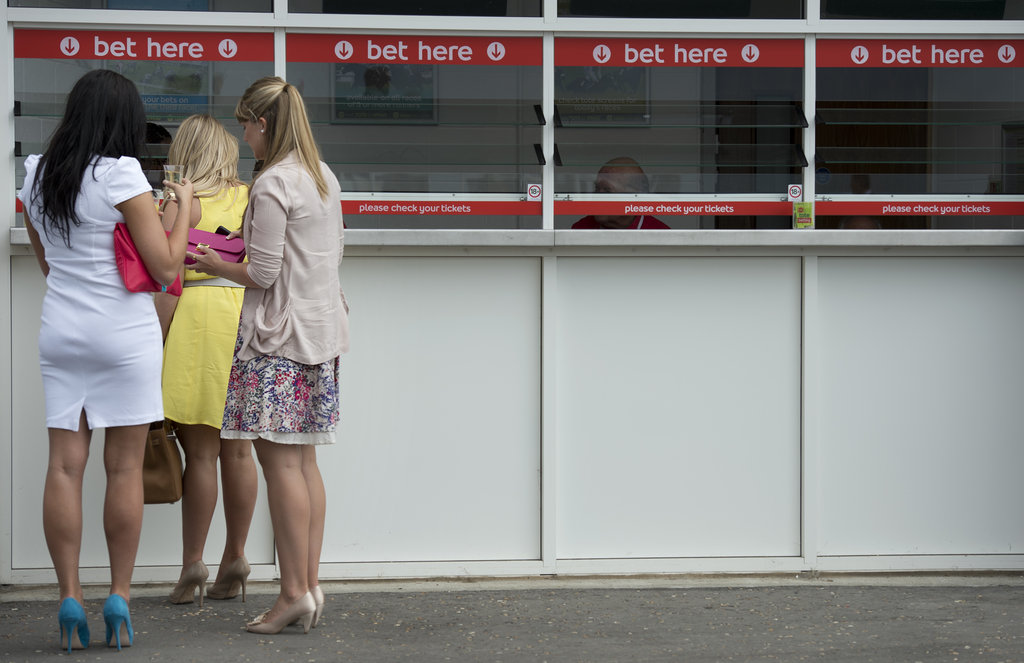 Women lined up to place bets at the races.