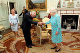 The queen shook hands with former Australia prime minister John Howard and his wife before presenting him with the Order of Merit.