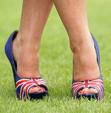 A woman posed in her Union Flag pumps at the races.