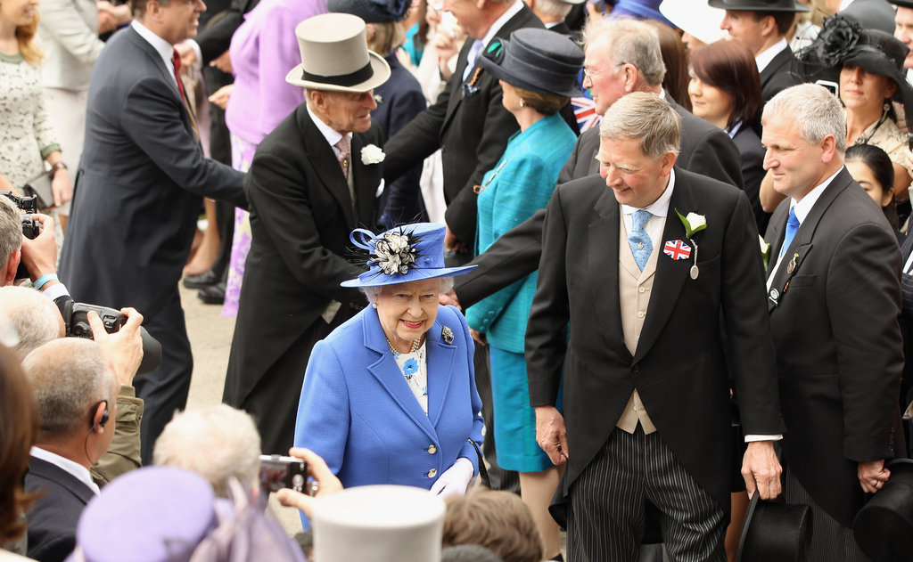 The queen and Prince Philip greeted fellow racegoers.