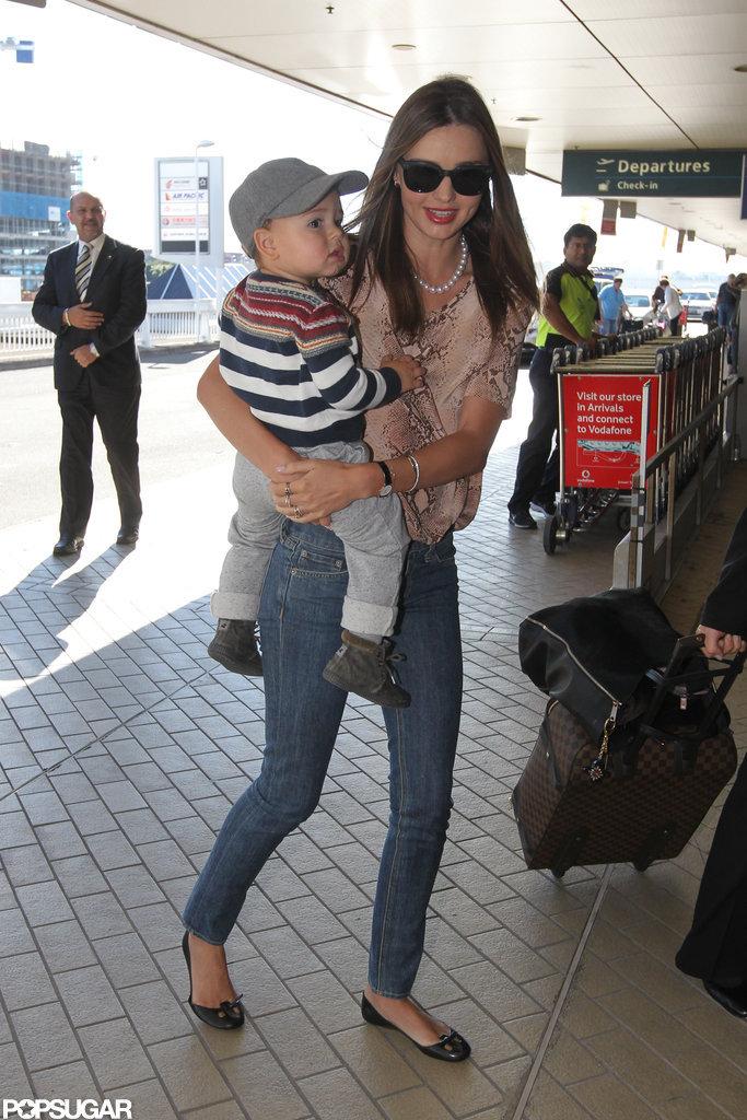 Miranda Kerr carried son, Flynn Bloom, at the Sydney airport.