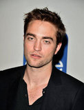 Robert Pattinson paired a casual polo with a black jacket.