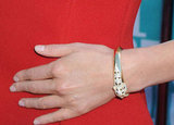 Charlize Theron played up the glamour of her look with Cartier jewels.
