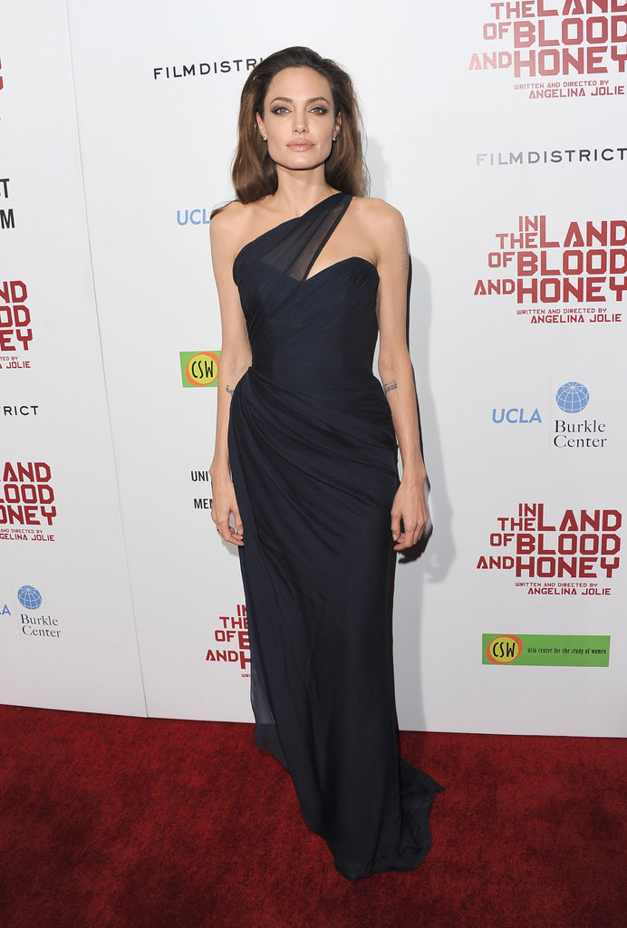 A dramatic asymmetrical neckline made this Romoa Keveza navy number stand out at the Hollywood premiere of In the Land Of Blood and Honey.