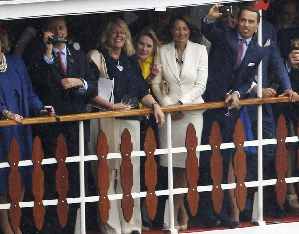 Carole Middleton dressed in a cream dress and jacket combo.