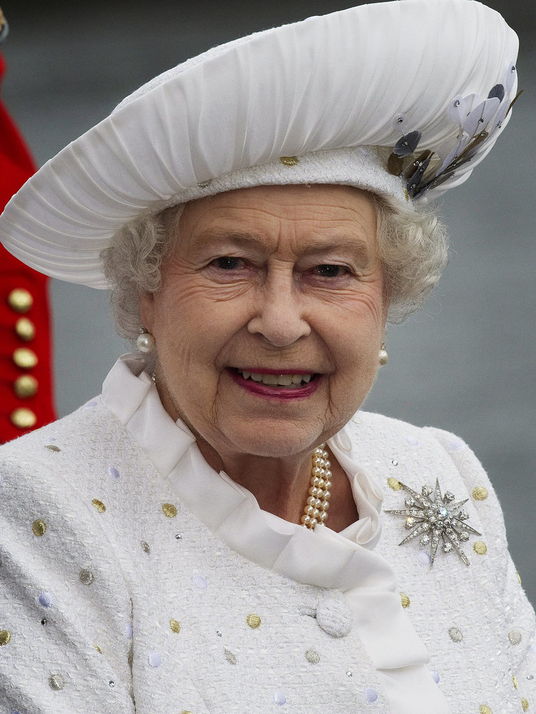 The feathers on the Queen's hat were hand dyed at Buckingham Palace by Angela Kelly's team. She wore her Jardine Star, pearl Ladies of Devonshire earrings and the necklace that was a wedding present from Queen Mary.
