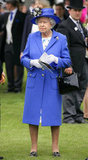 For Epsom Derby on Saturday, the Queen wore a white silk dress with blue floral print plus a royal blue Stewart Parvin crepe wool coat and matching hat by Rachel Trevor Morgan.