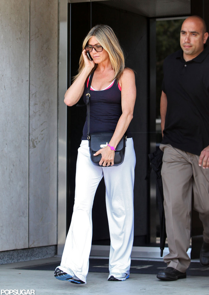 Jennifer Aniston wore white pants to work out.