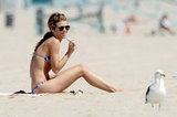 AnnaLynne McCord talked on her phone while lounging on the beach.