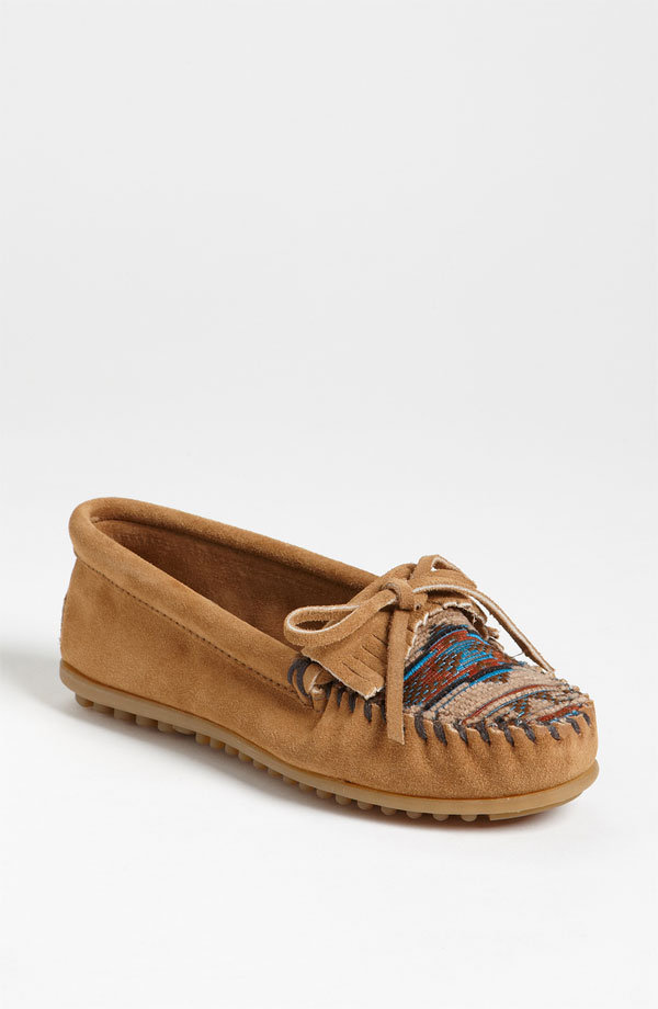 Slip on these flat beaded mocassins for the ultimate in cool comfort while you make your way from stage to stage. Minnetonka El Paso II Suede Moccasin ($40)
