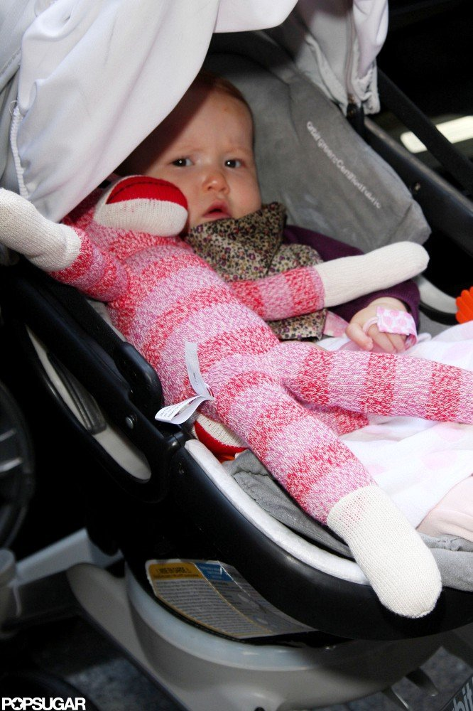 Haven Warren had a pink stuffed monkey with her in her stroller as she was pushed out of her NYC hotel by mom Jessica Alba.