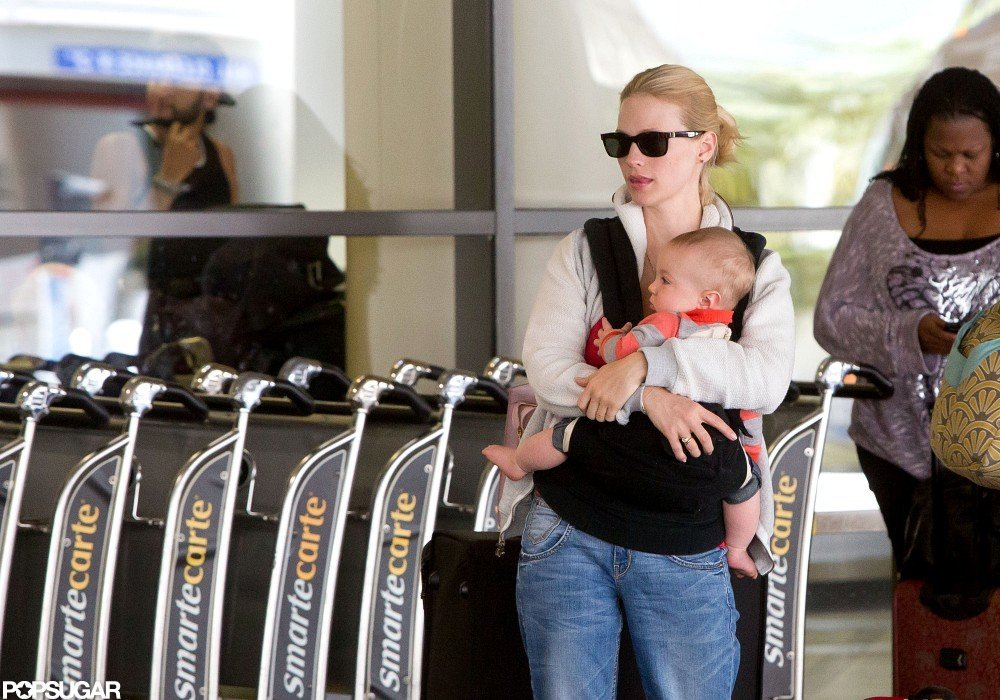 January Jones held Xander in a baby carrier at LAX.