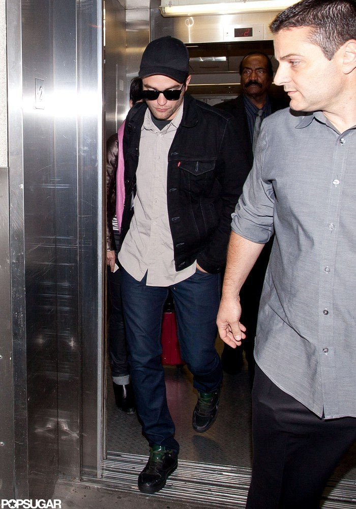 Robert Pattinson arrived at LAX after a minitour on for Cosmopolis.