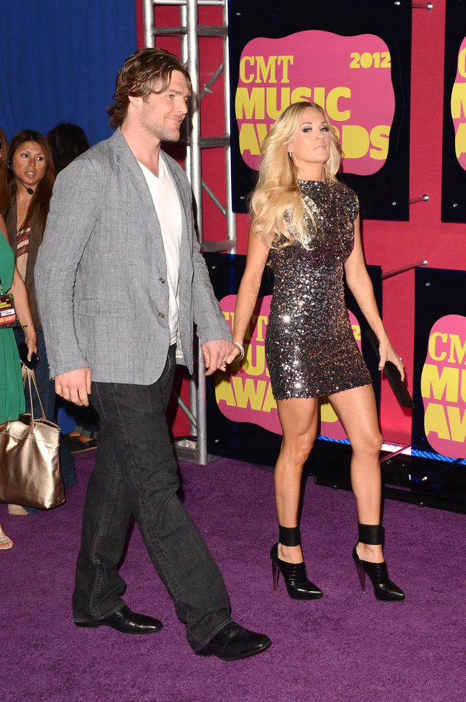 Carrie Underwood was accompanied by husband Mike Fisher at the CMT Music Awards.