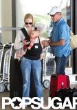 January Jones held Xander at LAX.