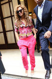 Beyoncé stepped out in bold loose-fitted pink pants — and a zigzag printed Carven top — in Paris.
