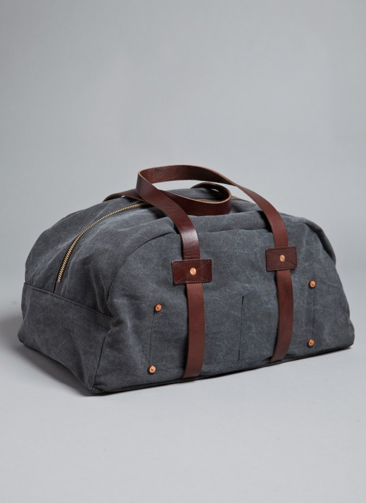 He'll love this canvas duffle bag for weekend getaways — and your mom won't have to be embarrassed by his old ripped-up suitcase anymore.  Billy Reid Canvas Duffle Bag ($375)