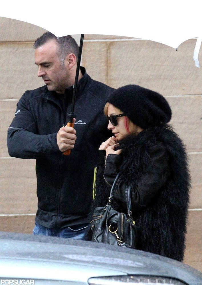 Nicole Richie dodged the rain under an umbrella in Australia.