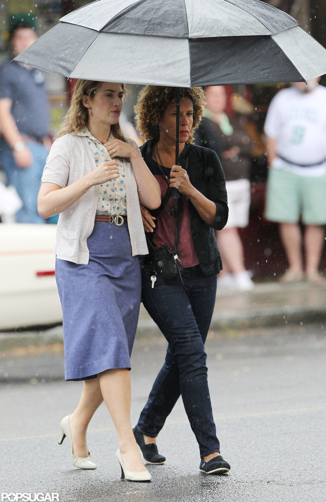 Kate Winslet walked through the rain on the set of Labor Day.
