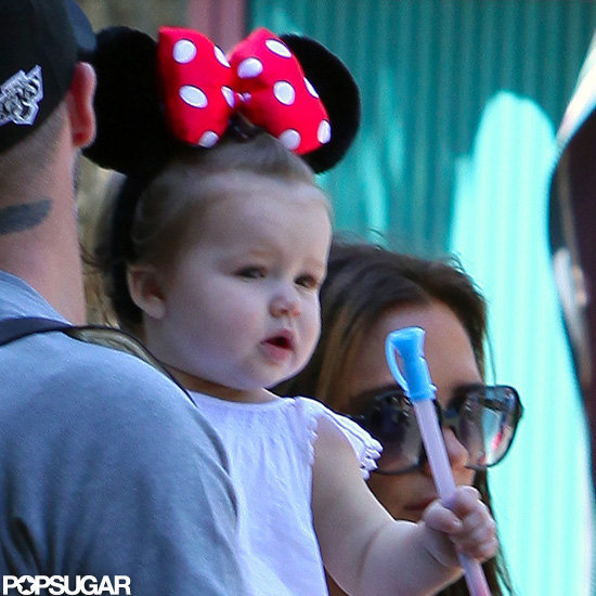Harper Beckham looked adorable in a pair of Minnie Mouse ears at Disneyland with parents David and Victoria Beckham.