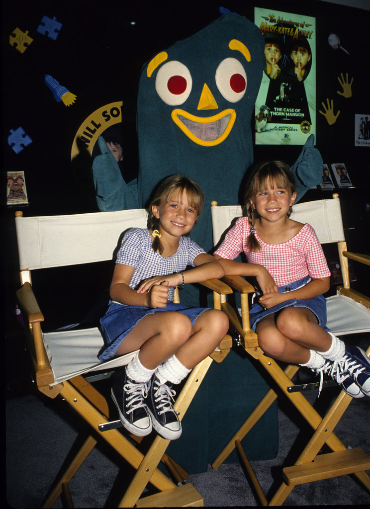 Mary-Kate Olsen and Ashley Olsen wore matching denim skirts to pose with Gumby in the '90s.