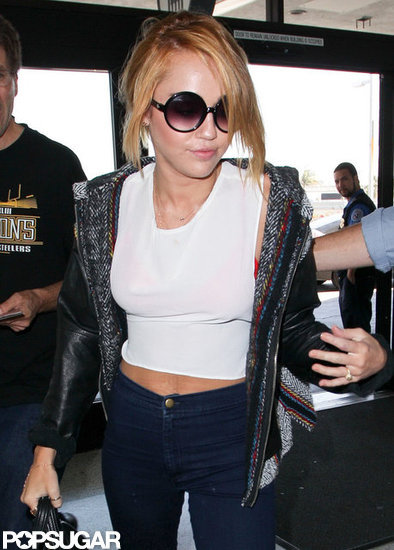 Miley Cyrus got engaged to Liam Hemsworth! She showed off her engagement ring boarding a plane at LAX.
