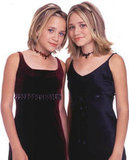 Mary-Kate Olsen and Ashley Olsen dressed up in velvet for the launch of their pocket planner in November 2000.
