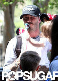 David Beckham carried baby Harper, wearing Minnie Mouse ears, during a trip to Disneyland.