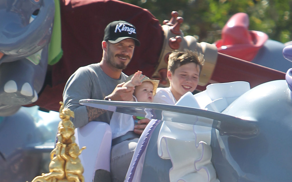 David Beckham, Harper Beckham, and Brooklyn Beckham enjoyed their time on a ride at Disneyland.