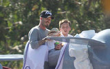 David Beckham laughed with Harper Beckham and Brooklyn Beckham on a ride at Disneyland.