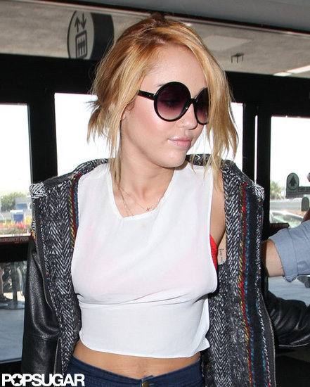 Miley Cyrus got onto a plane at LAX.