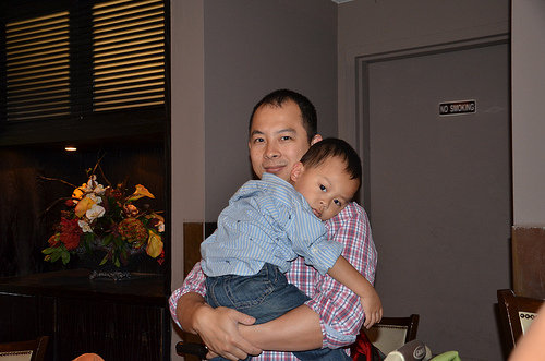 """Here's a pic of my husband, Henry, and our son, Ryan. He and Daddy were sporting their dress shirts with rolled-up sleeves, for the ladies (mainly Mommy)."" — Oda Sham, ad operations director"