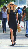 Jessica Hart zeroed in on effortless Summer style — a head-to-toe look we'll be replicating — while out in NYC's West Village. The model wore a black Pencey Standard t-shirt dress with loafers and a floppy straw hat.