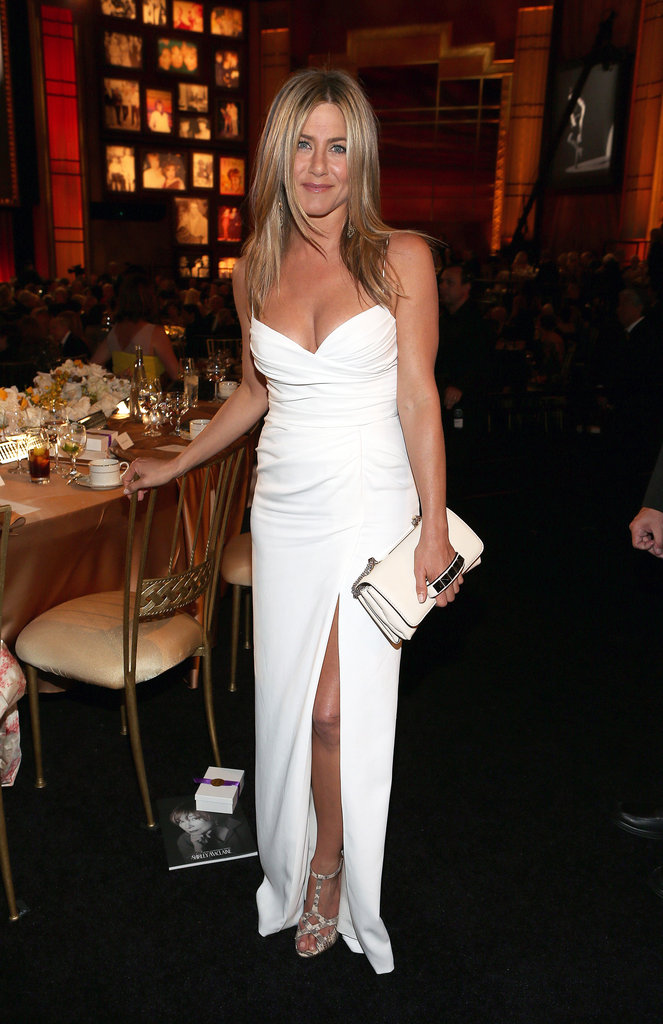 Jennifer Aniston surprised us all by ditching her usual LBDs in favor of a totally sexy white Burberry gown at the AFI Life Achievement Awards.