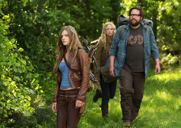 Tracy Spiridakos as Charlie, Zak Orth as Aaron, and Anna Lise Phillips as Maggie on Revolution.