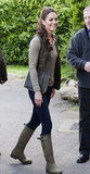 Kate Middleton wore a green vest and rain boots to visit with children from Expanding Horizons primary school outdoor camp.