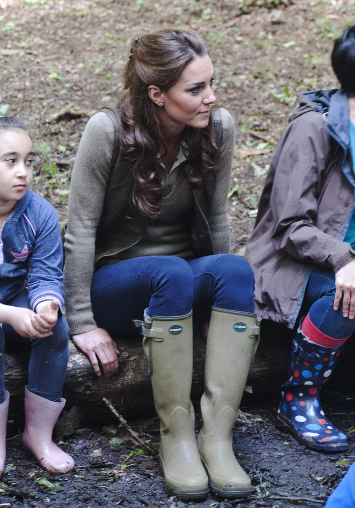 Kate Middleton wore rain boots for her visit to Expanding Horizons primary school outdoor camp.