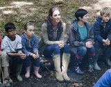 Kate Middleton relaxed by a campfire with children from Expanding Horizons' primary school outdoor camp.