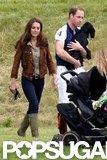 Kate Middleton walked beside Prince William as he carried Lupo through the field.