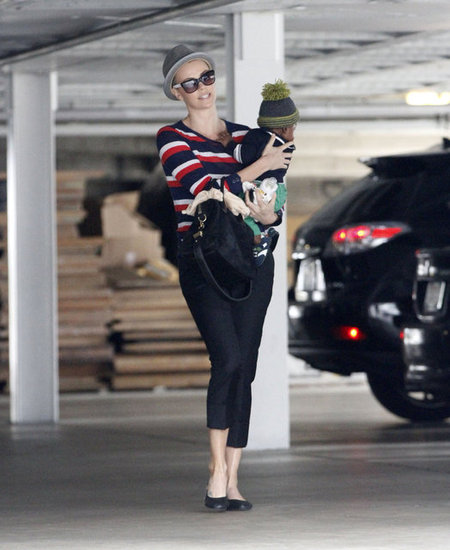 Charlize Theron looked cute in a fedora and shades as she carried baby Jackson.