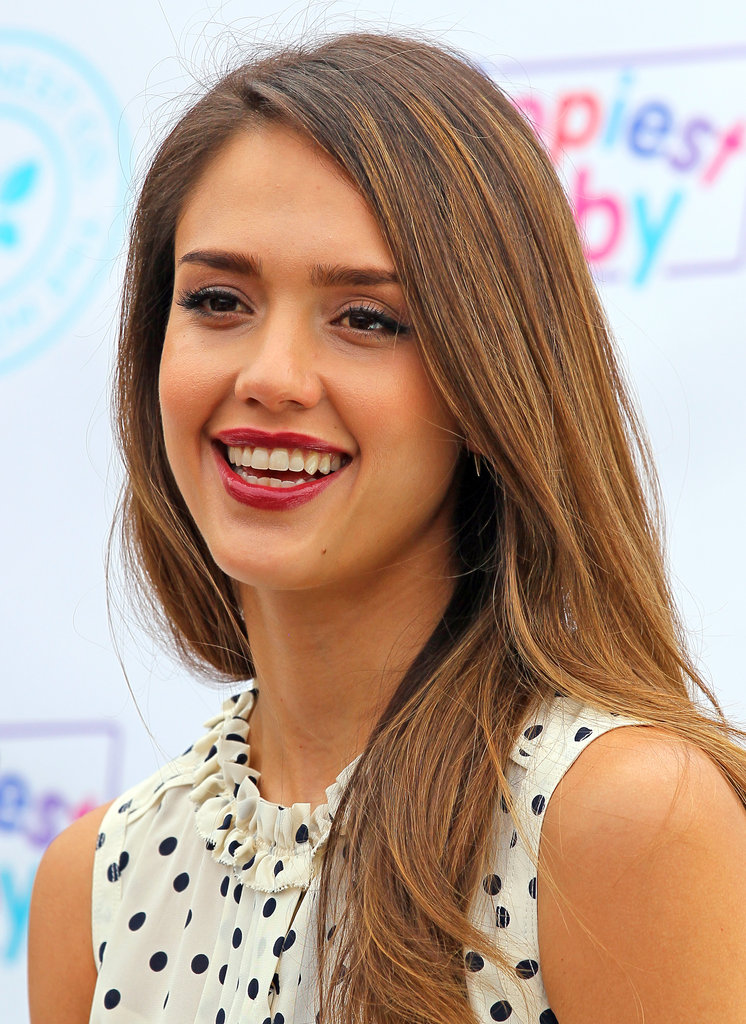 Jessica Alba wore red lipstick at the event.