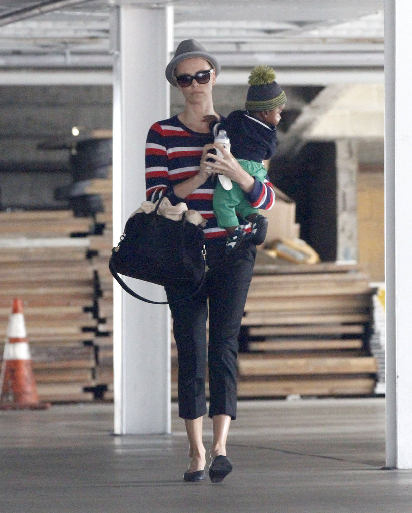 Charlize Theron carried a purse in one hand and baby Jackson in the other.