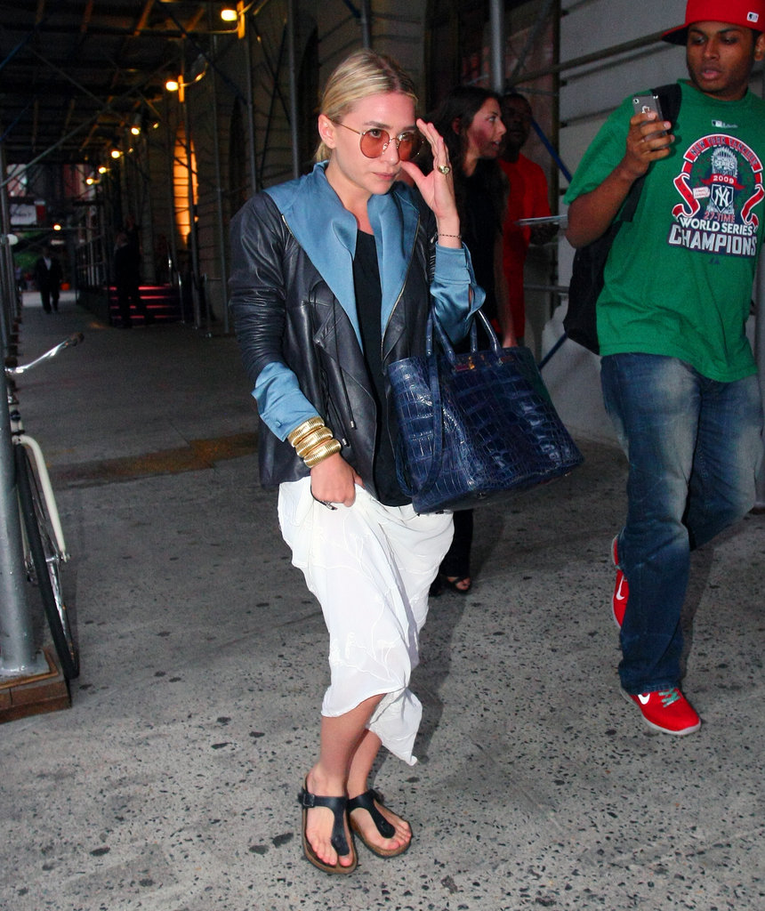 Ashley Olsen pictured in round sunglasses.