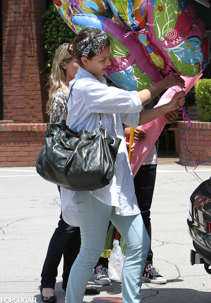 Jessica Alba carried a few balloons after the party.