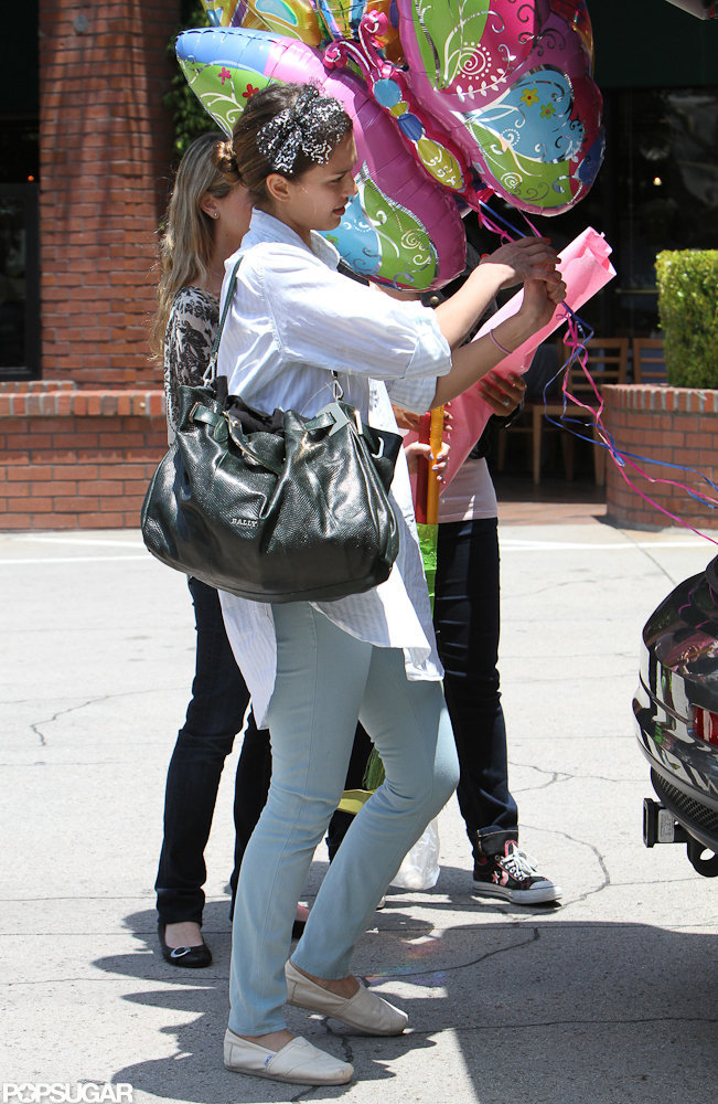 Jessica Alba carried a butterfly balloon out of the birthday party.