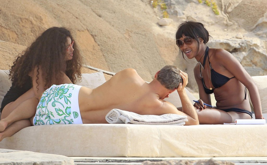 Naomi Campbell chatted with friends in a bikini in Ibiza.