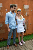 Diane Kruger gave her little eyelet dress a retro twist with Converse kicks and a straw fedora.