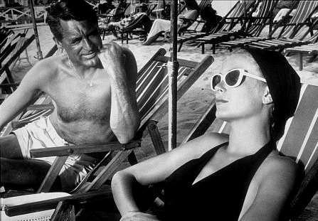 Grace Kelly perfected glamour at the beach in To Catch a Thief and inspired us to embrace white shades and a luxurious cover-up.