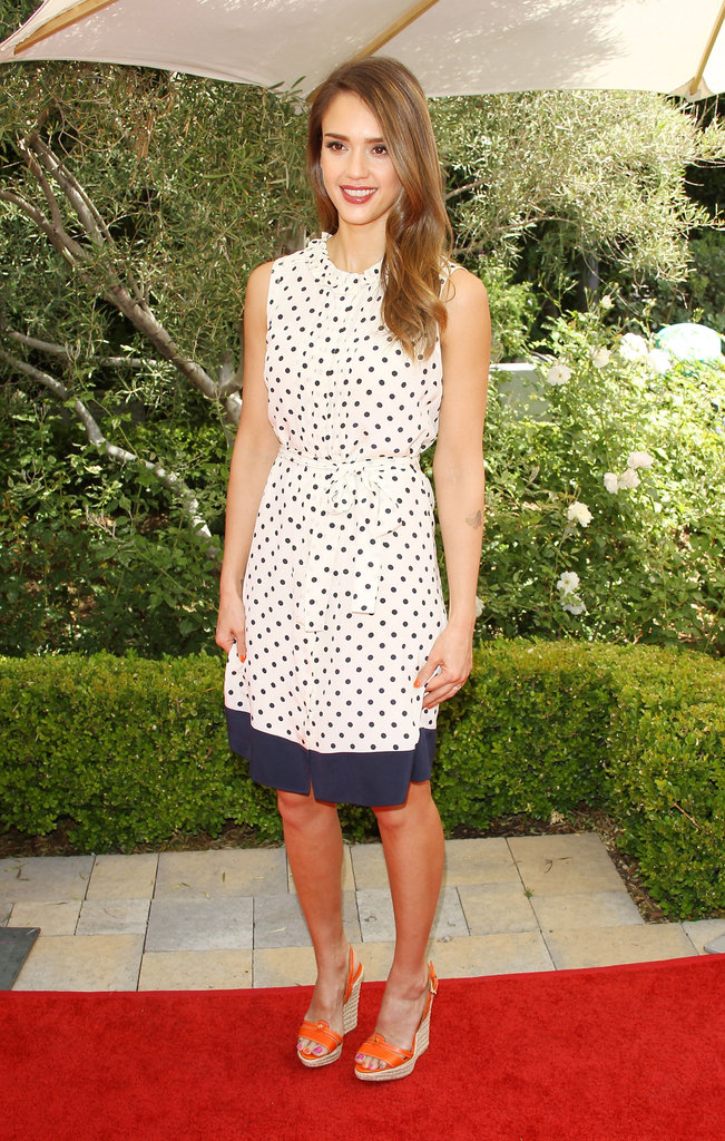 Jessica Alba showed off a pretty printed polka-dot dress by Tory Burch paired with orange wedge sandals at an event in LA.