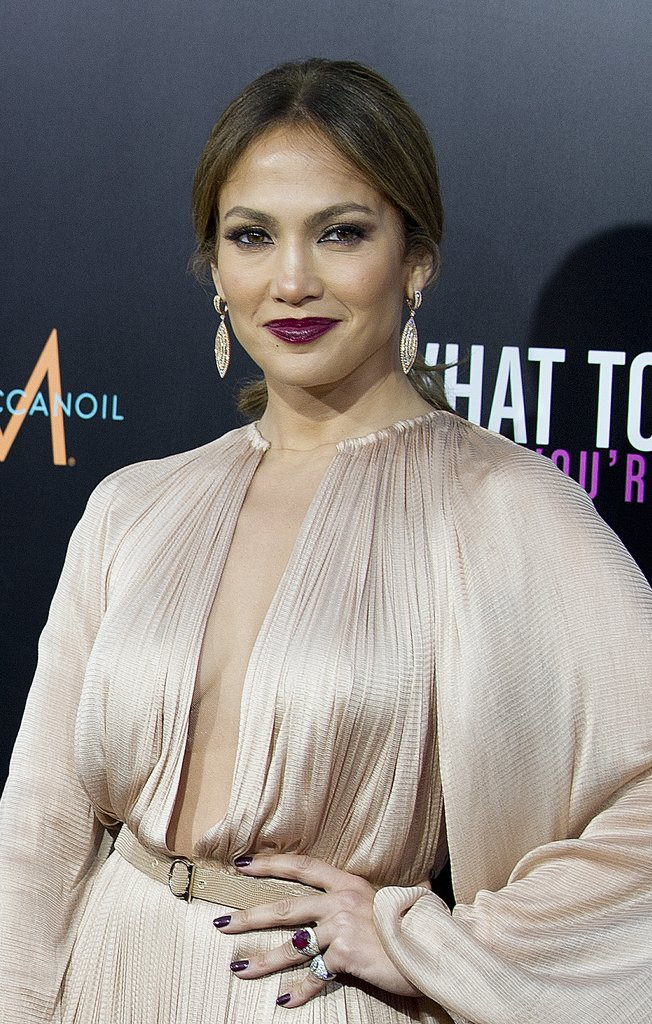 Jennifer Lopez accessorized her disco-inspired dress and moody lipstick with double cocktail rings. 7126061